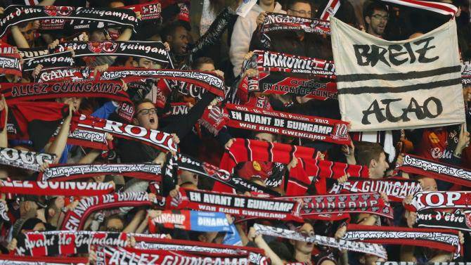 Supporters of Guingamp cheer for their team during their Europa League Group K soccer match against Fiorentina at the Roudourou stadium in Guingamp