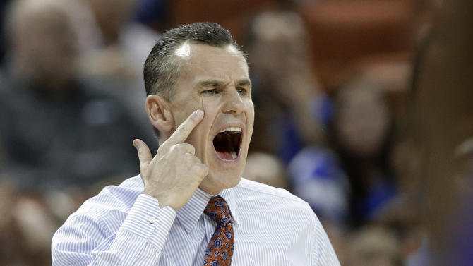 Florida coach Billy Donovan talks to his players during the first half of a second-round game against Northwestern State in the NCAA men's college basketball tournament Friday, March 22, 2013, in Austin, Texas.  (AP Photo/Eric Gay)