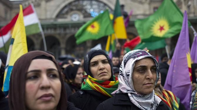 Demonstrators of Kurdish origin gather to protest after the killing of three Kurdish women activists in Paris, Saturday, Jan. 12, 2013. (AP Photo/Thibault Camus)