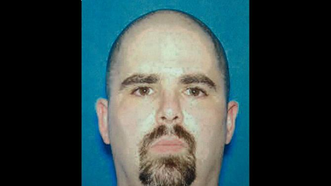 This undated photo provided by the FBI on Monday, Aug. 6, 2012 shows Wade Michael Page, a suspect in the Sunday, Aug. 5, 2012 Sikh temple shootings in Oak Creek, Wis. (AP Photo/FBI)