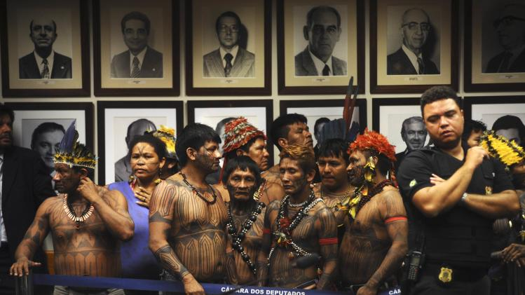 Munduruku Indians protest inside Congress against the law project called PEC 215 being debated by the Lower House in Brasilia
