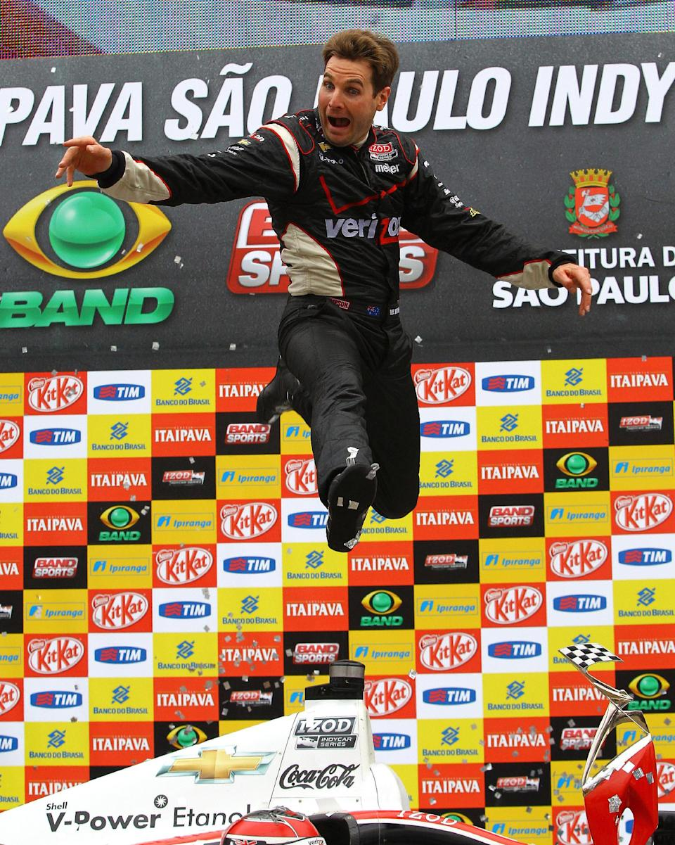 Will Power celebrates after winning the IndyCar Series Sao Paulo 300 auto race on Sunday, April 29, 2012, in Sao Paulo, Brazil. (AP Photo/LAT, Carsten Horst)  MANDATORY CREDIT