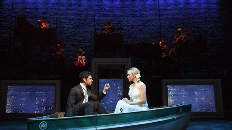 "This theater image released by The Hartman group shows Adam Kantor, left, and Betsy Wolfe during a performance of ""The Last Five Years,"" in New York. (AP Photo/The Hartman Group, Joan Marcus)"