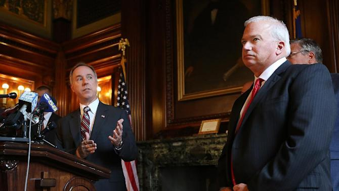 Wisconsin Assembly Speaker Robin Vos, R-Rochester, left, speaks about the ongoing state budget deliberations during a press conference held by the Republican legislative leaders as Senate Majority Leader Scott Fitzgerald, R-Juneau, looks on in the Senate Parlor of the Wisconsin State Capitol in Madison, Wis., on Wednesday, July 1, 2015. (John Hart/Wisconsin State Journal via AP)