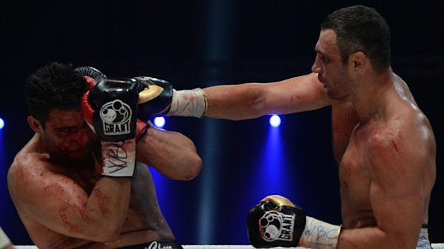 : Ukraine's two-time World Heavyweight champion Vitali Klitschko (R) fights for the defense his WBC heavyweight title against Germany's Manuel Charr in Moscow (AFP)