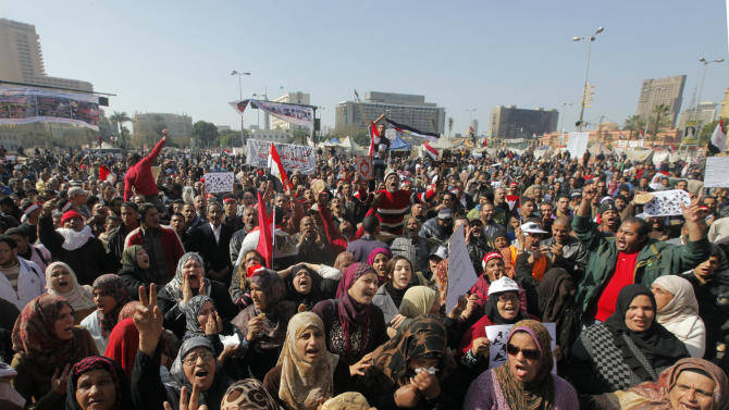 Egyptian protesters shout anti-government slogans and display bread to symbolize the high number of people living in poverty, during a protest in Tahrir Square, in Cairo, Egypt, Friday, Feb. 8, 2013. Thousands of Egyptians are staging rallies in cities across the country to denounce the rule of Islamist President Mohammed Morsi and his fundamentalist Muslim Brotherhood group. (AP Photo/Amr Nabil)