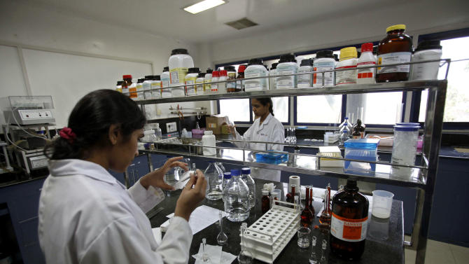 FILE – In this March 13, 2012 file photo, Indian scientists work inside a laboratory of the Research and Development Centre of Natco Pharma Ltd., in Hyderabad, India. India's patent appeals office on Monday, March 4, 2013, rejected international drug maker Bayer AG's plea to stop Indian company Natco Pharma Ltd. from manufacturing a cheaper generic version of a patented cancer drug.  (AP Photo/Mahesh Kumar A., File)