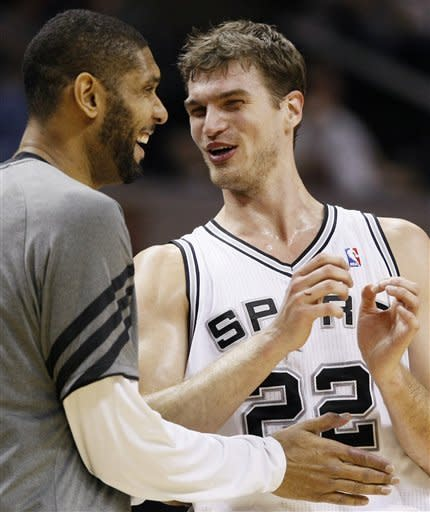 Green scores 24 points, Spurs top Nuggets 121-117