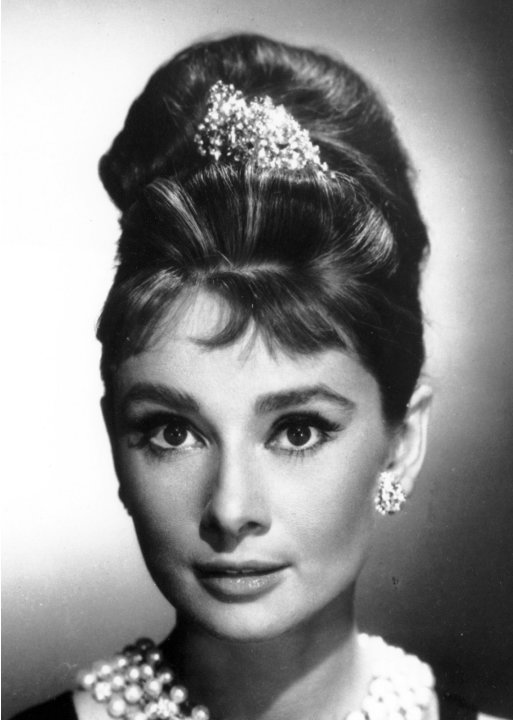 FILE-   In this 1961 file photo actress Audrey Hepburn, with her hair up in a beehive, poses as Holly Golightly in the 1961 movie