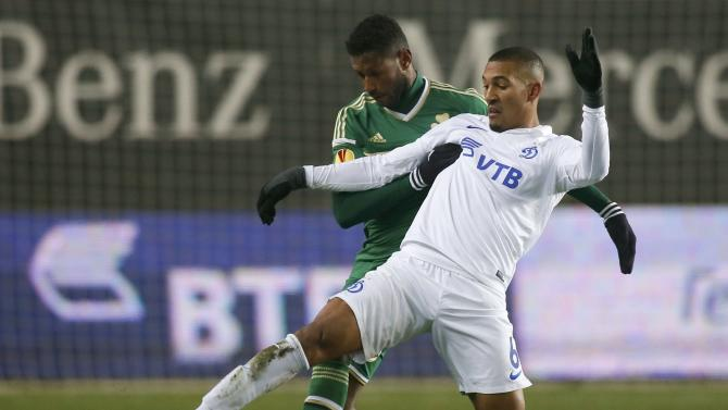 Dinamo Moscow's William Vainqueur fights for the ball with Panathinaikos' David Mendes during their Europa League soccer match at the Arena Khimki stadium outside Moscow