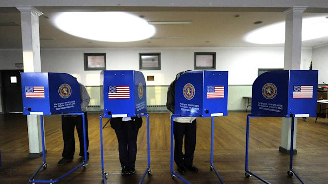 Early morning voting is underway at Bishop Molloy Recreational Center on Tuesday, Nov. 6, 2012, in Point Lookout , N.Y., one of several voting locations that were created as a result of Superstorm Sandy.  (AP Photo/Kathy Kmonicek)