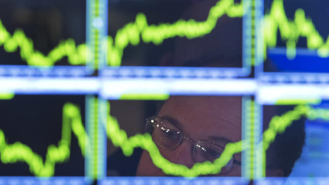 Stock market ends mixed after uneven earnings news