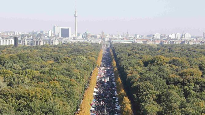 Consumer rights activists take part in a march to protest against TTIP in Berlin