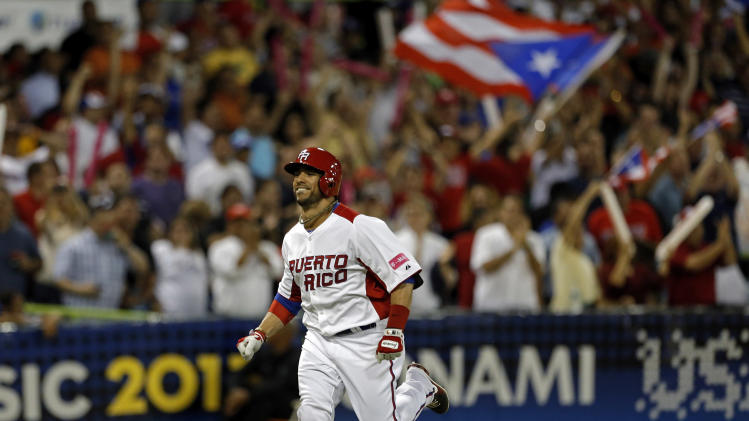 Puerto Rico's Mike Aviles rounds the bases after hitting a two run home run in the 4th inning of the World Baseball Classic first round game against the Dominican Republic in San Juan, Puerto Rico, Sunday, March 10, 2013. (AP Photo/Andres Leighton)