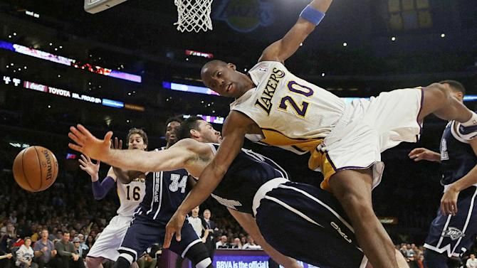 Los Angeles Lakers guard Jodie Meeks (20) is fouled by Oklahoma City Thunder forward Nick Collison (4) in the first half of an NBA basketball game in Los Angeles, Sunday, Jan. 27, 2013. The Lakers won 105-96. (AP Photo/Reed Saxon)