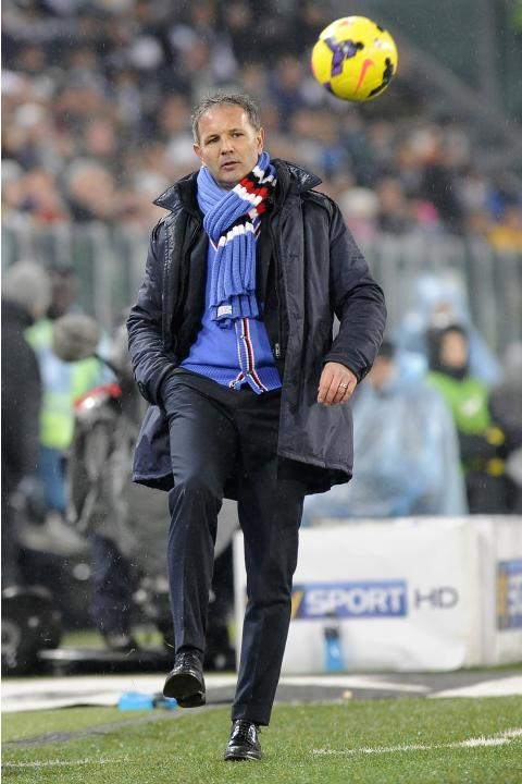 Sampdoria' coach Mihajlovic controls the ball during their Italian Serie A soccer match against Juventus at Juventus Stadium in Turin