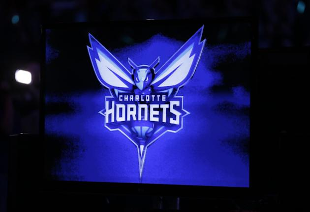 The new logo of the Charlotte Hornets is displayed on a video monitor during a halftime ceremony of an NBA basketball game between the Charlotte Bobcats and the Utah Jazz in Charlotte, N.C., Saturday,