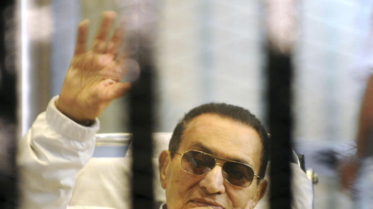 FILE -- In this Saturday, April 13, 2013 file photo, former Egyptian President Hosni Mubarak waves to his supporters from behind bars as he attends a hearing in his retrial on appeal in Cairo, Egypt. On Saturday, June 8, 2013 the judge in the retrial of Mubarak rejected a request by civil defense lawyers to participate in the hearings. The former president, who ruled Egypt for nearly 30 years, is accused of corruption and collusion in the killing of nearly 900 protesters during the 2011 revolt that ousted him. (AP Photo, File)