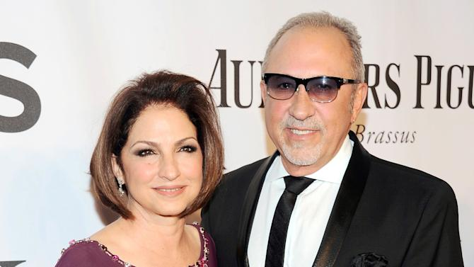 """FILE - In this June 8, 2014, file photo, Gloria Estefan, left, and Emilio Estefan pose for photos at the 68th annual Tony Awards at Radio City Music Hall in New York. Producers of """"On Your Feet!"""" a musical about the Estefans, said Monday, Aug. 18, 2014, they'll offer performers around the world a chance to audition for all the roles in the Broadway cast by submitting audition videos online. There also will be two open casting calls _ at Pearl Studios in New York City on Sep. 9 and at the Adrienne Arsht Center for the Performing Arts in Miami on Sept. 21. (Photo by Charles Sykes/Invision/AP, File)"""
