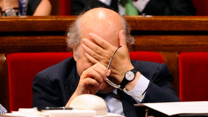 Catalonia's Economy Minister Andreu Mas-Colell reacts during a extraordinary parliamentary session on the fiscal pact at the Parliament of Catalonia in Barcelona, Spain, Wednesday, July 25, 2012. The powerful northeastern region of Catalonia admitted Tuesday it was studying  a possible for request for help but said no decision had been made and stressed that the credit line did not constitute a rescue or bailout of the region. Since Friday, two regions, Valencia and Murcia, have said they will tap an a 18 billion euro emergency credit line  the central government recently set up for cash-strapped regions.. (AP Photo/Manu Fernandez)