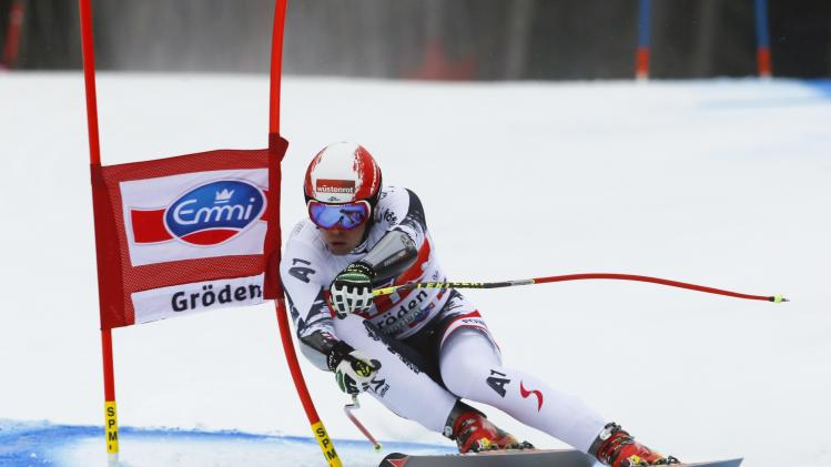 Puchner of Austria clears a gate during the men's World Cup Super-G skiing race in Val Gardena
