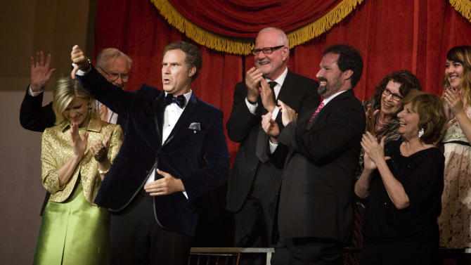Actor Will Ferrell, who is receiving the nation's top humor prize, gives a comedic thumbs down to the audience at the Kennedy Center for the Performing Arts Sunday, Oct. 23, 2011, in Washington.  (AP Photo/Kevin Wolf)