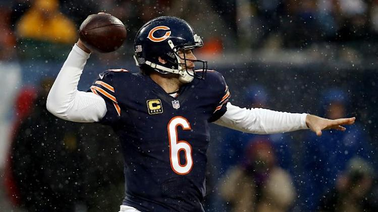 Quarterback Jay Cutler of the Chicago Bears passes against the Green Bay Packers during a game at Soldier Field on December 29, 2013 in Chicago, Illinois