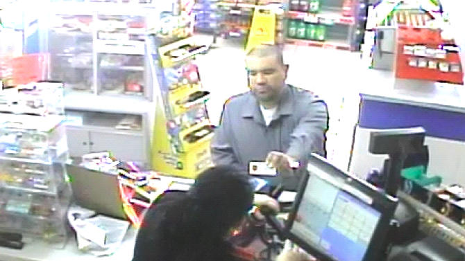 This photo made from a surveillance camera on May 12, 2013, which was provided by the Omaha Police Department on July 17, 2013, shows a person resembling Dr. Anthony Garcia making a purchase at a Casey's General Store in Council Bluffs, Iowa, which is just east of Omaha. Garcia has been arrested on suspicion of killing four people in Omaha, Neb., with ties to the Creighton medical school in two separate attacks five years apart. Garcia, who lives in Terre Haute, Ind., was arrested by Illinois State Police on Monday, July 15, 2013 during a traffic stop in Union County, in southern Illinois. (AP Photo/Omaha Police Department)