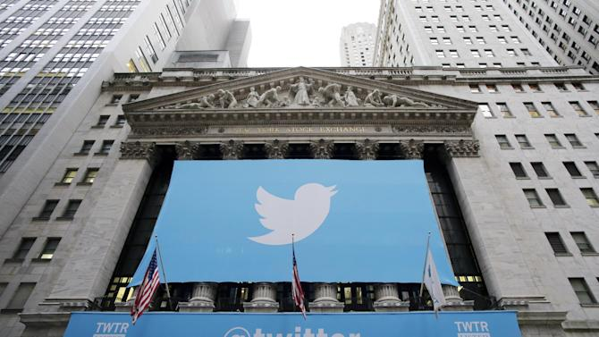 "Twitter signage is draped on the facade of the New York Stock Exchange, Thursday, Nov. 7, 2013 in New York. Twitter set a price of $26 per share for its initial public offering on Wednesday evening and will begin trading Thursday under the ticker symbol ""TWTR"" in the most highly anticipated IPO since Facebook's 2012 debut. (AP Photo/Mark Lennihan)"