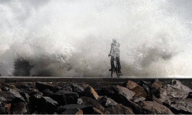 A man is drenched by a large…