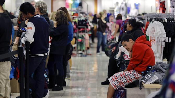 FILE - In this  Friday, Nov. 23, 2012, file photo, a teenage boy waits for his family to finish shopping at a J.C. Penney store in Las Vegas. Black Friday. Major retailers such a on Thursday, Nov. 29, 2012, reported weak sales in November as a strong start the holiday shopping season over the Thanksgiving weekend wasn't enough to fully offset a slow start to the month caused by Superstorm Sandy  (AP Photo/Julie Jacobson)
