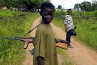 File photo of child soldiers in Voinjama, Liberia. Under-aged combatants have existed for time immemorial. Alexander the Great trained as a child soldier, and desperate armies in both world wars enlisted and coerced youth fighters. But the practice has only been on the world &quot;radar&quot; for the past 20 years