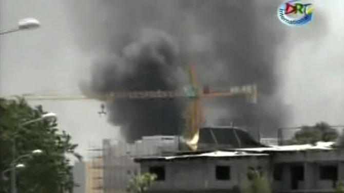 This video image made from DRTV shows a cloud of smoke rising into the sky as blasts rocked Brazzaville, the capital of the Republic of Congo Sunday March 4, 2012 after a weapons depot caught fire.  Officials in the Congo said an unknown numbers of people were killed and wounded and some 2,000 people were forced to flee their homes. The explosions shook houses in Brazzaville and echoed across the Congo River to the capital of the neighboring country.   (AP Photo/DRTV)  REPUBLIC OF CONGO OUT