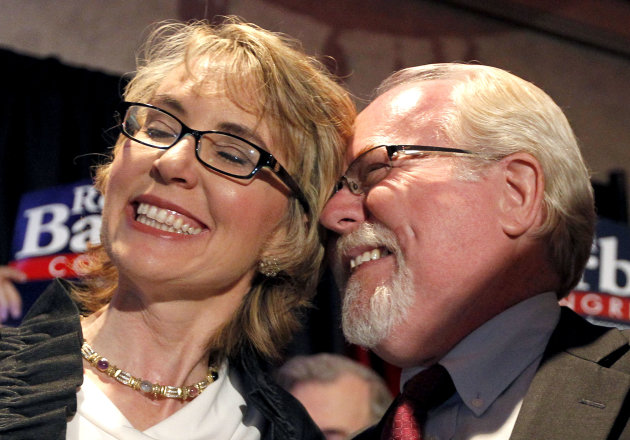 In an election to fill former Rep. Gabrielle Giffords, D-Ariz., congressional seat, Democratic candidate Ron Barber, right, celebrates a victory with Giffords, left, as he gives her a hug prior to spe