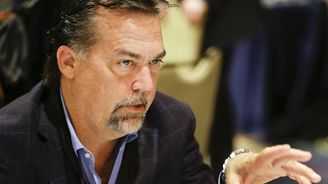 St. Louis Rams head coach Jeff Fisher talks with reporters during the NFC Head Coaches Breakfast at the NFL football meetings in Orlando, Fla., Wednesday, March 26, 2014. (AP Photo/John Raoux)