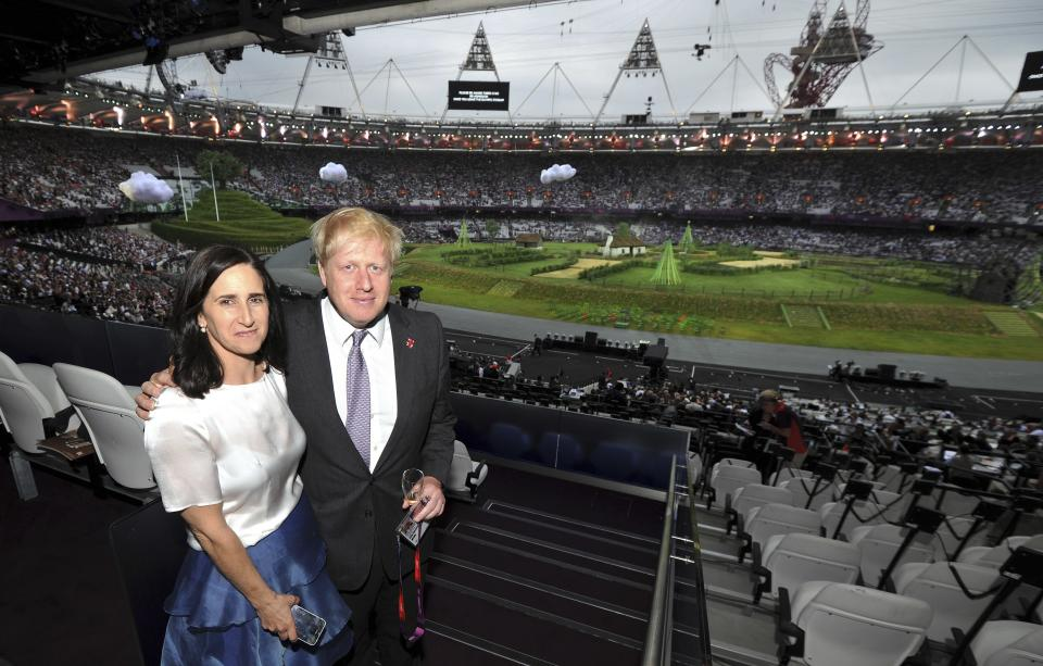 The Mayor of London Boris Johnson, left, and his wife Marina Wheeler arrive for the start of the Opening Ceremony of the 2012 Olympic Summer Games at the Olympic Stadium in London, Friday, July 27, 2012. (AP Photo/John Stillwell, pool)