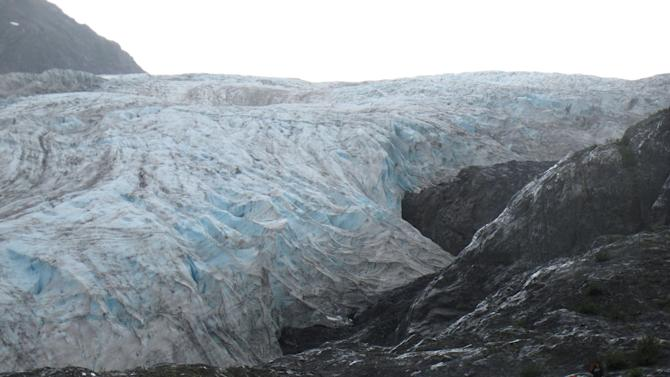 This photo taken Aug. 4, 2012, shows tourists walking to Exit Glacier in Kenai Fjords National Park just outside Seward, Alaska. The glacier is a popular destination for cruise ship passengers visiting the port city of Seward, about 110 miles south of Anchorage, Alaska. (AP Photo/Mark Thiessen)