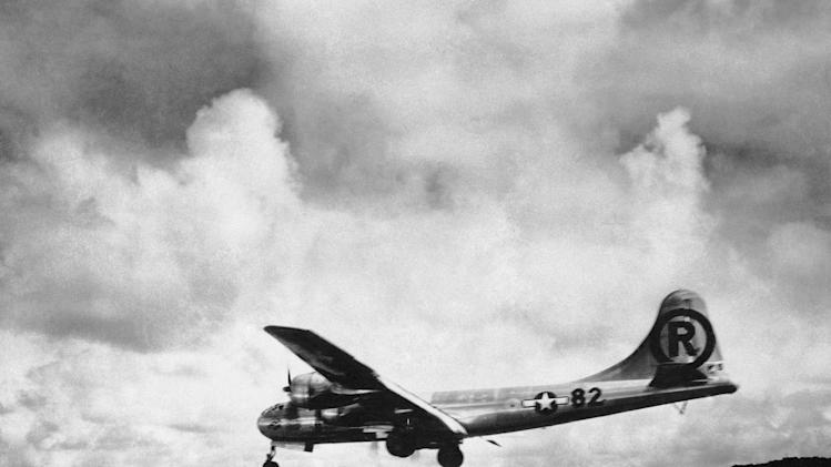 "FILE - In this Aug. 6, 1945 file photo, the ""Enola Gay"" Boeing B-29 Superfortress lands at Tinian, Northern Mariana Islands after the U.S. atomic bombing mission against the Japanese city of Hiroshima. Tom VanKirk says his 93-year-old father, the last surviving member of the Enola Gay crew, died in Stone Mountain, Ga. on Monday, July 28, 2014. (AP Photo/Max Desfor)"