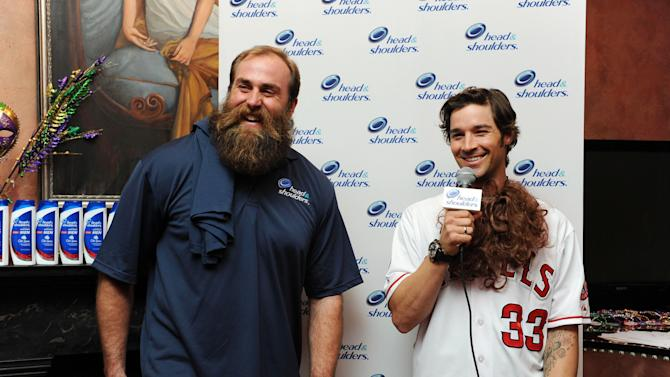 "IMAGE DISTRIBUTED FOR HEAD & SHOULDERS - Head & Shoulders and Pittsburgh Steelers Brett Keisel reveals L.A. Angels pitcher C.J. Wilson as new ""Mane Man"" during a media event at famed Pat O'Briens surrounding Super Bowl XLVII , on Wednesday, Jan. 30, 2013 in New Orleans, LA. (Photo by Cheryl Gerber/Invision for Head & Shoulders/AP Images)"