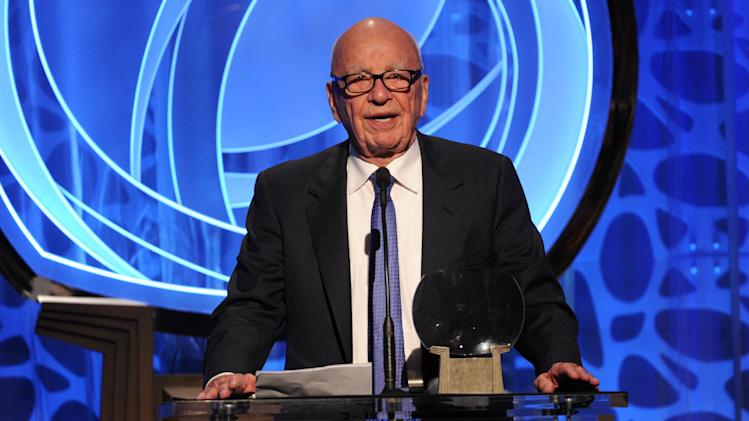EXCLUSIVE - Hall of Fame inductee Rupert Murdoch speaks on stage at the 2014 Television Academy Hall of Fame on Tuesday, March 11, 2014, at the Beverly Wilshire in Beverly Hills, Calif. (Photo by Frank Micelotta/Invision for the Television Academy/AP Images)