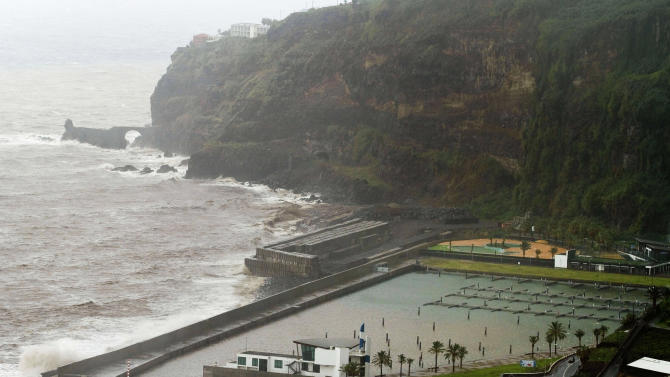 In this photo taken Oct. 30, 2012, waves crash against the wall of the recently built and yet to be used Lugar de Baixo Marina in Ponta de Sol, in the Portuguese island of Madeira. The EU's aid policy for less well-off parts of the continent, meant to help bridge the wealth gap between rich areas of the bloc and poor, has done much to boost livelihoods. But the bonanza of easy money also bred political vanity projects, bridges to nowhere, lax oversight and widespread corruption, and wiser investments that might sustain long-term growth were often neglected. (AP Photo/Joana Sousa)