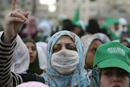 A Hamas supporter wearing a protective mask against swine flu at a rally in Gaza City in 2009. Nine Palestinians have died in a new outbreak of the H1N1 influenza strain known as swine flu, the office of Palestinian prime minister Salam Fayyad said on Saturday