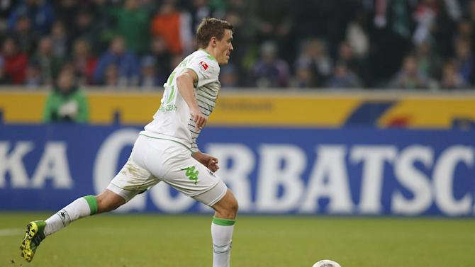Moenchengladbach's striker Max Kruse scores from the penalty spot during the German first division Bundesliga football match Borussia Moenchengladbach vs FC Schalke 04 in Moenchengladbach, on December 7, 2013
