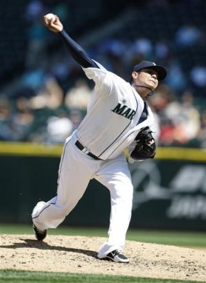 Hernandez, Mariners sweep away Royals 7-6