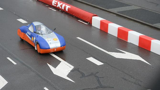 IMAGE DISTRIBUTED FOR SHELL - The Schluckspecht 4, vehicle No. 514, UrbanConcept, running on Diesel, competing for team Schluckspecht from University of Applied Sciences Offenburg, Germany, on the track during Day 1 of competition at the Shell Eco-marathon Challenge Europe at The Ahoy centre in Rotterdam, The Netherlands on Thursday, May 16, 2013. Teams from universities all over Europe have brought their energy efficient cars to compete through the three-day challenge. (Ermindo Armino/AP Images for Shell)