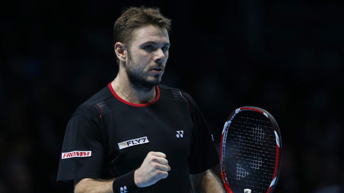 Stanislas Wawrinka of Switzerland pumps his fist after winning a point against David Ferrer of Spain during their ATP World Tour Finals single tennis match at the O2 Arena in London Friday, Nov. 8, 2013. (AP Photo/Sang Tan)