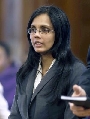 FILE - In this Jan. 9, 2013 file photo, Annie Dookhan, a former Massachusetts chemist accused of faking test results at a state drug lab, pleads not guilty during her arraignment at Superior Court, in Dedham, Mass. State officials estimate that Dookhan tested samples involving more than 40,000 defendants during her nine years at a state Department of Public Health lab. The Executive Office of Public Safety says more than 330 defendants have been released from prisons. (AP Photo/Steven Senne, Pool, File)