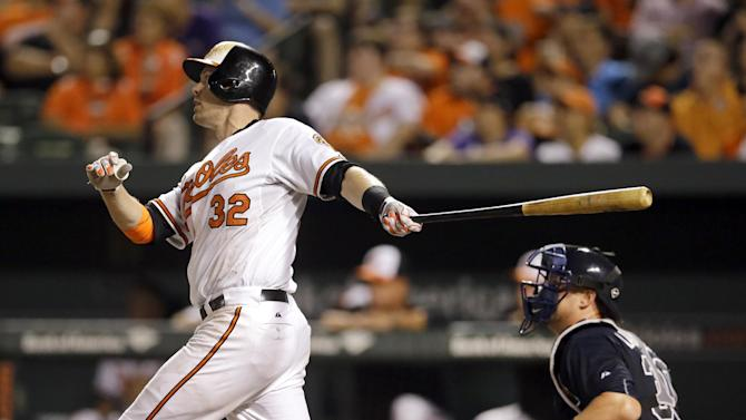 Baltimore Orioles' Matt Wieters, left, watches his solo home run in front of Atlanta Braves catcher Ryan Lavarnway in the 11th inning of an interleague baseball game Monday, July 27, 2015, in Baltimore. Baltimore won 2-1 in 11 innings. (AP Photo/Patrick Semansky)