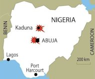 A suicide attack at the Abuja bureau of a top Nigerian newspaper and an attempted car bombing at another of its offices killed nine people Thursday in the first such strikes on the country's media
