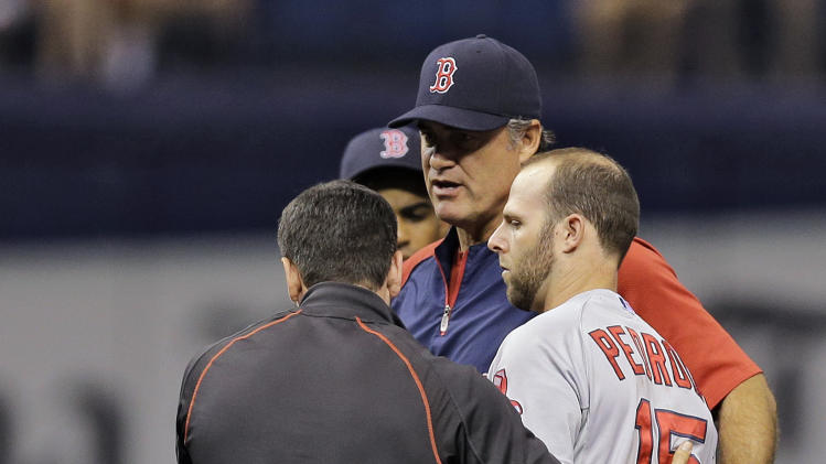 Boston Red Sox second baseman Dustin Pedroia, right, is helped to his feet by manager John Farrell, center, and a trainer after getting injured in a collision with Tampa Bay Rays' Logan Forsythe during the second inning of a baseball game Saturday, Aug. 30, 2014, in St. Petersburg, Fla. Pedroia left the game. (AP Photo/Chris O'Meara)